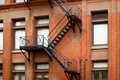 Old metal fire escape staircase Stock Photo