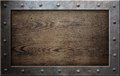 Old metal frame over wooden background Royalty Free Stock Photo