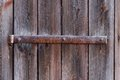 Old metal hinge iron in a door of an farm building Stock Photos