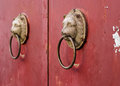 Old metal  knocker with lion head Royalty Free Stock Photo