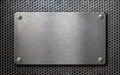 Old metal plate over grid metallic background Royalty Free Stock Photo