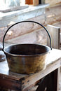 Old metal pot on wooden table closeup of in kitchen Stock Photo