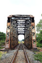 Old metal rail road bridge across the river Royalty Free Stock Photography