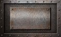 Old metal rusty or rustic plate over comb grid Royalty Free Stock Photo