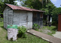 Old metal and wooden shed found in the dominican republic in the jungle Royalty Free Stock Images