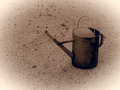 Old metallic watering can. Monochromatic vintage picture style Royalty Free Stock Photo