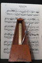 Old metronome with music in allegro sheet Stock Photography