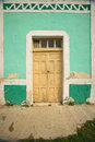 Old Mexican village of Celestun on Gulf of Mexico with old green building storefront Royalty Free Stock Photo