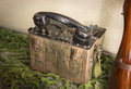 Old military field telephone vintage weathered wartime period soldier case portable rusty shortwave node demodulator with plastic Royalty Free Stock Images