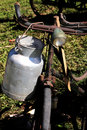 Old Milk Canister and rusty historic bike milkman Royalty Free Stock Photo