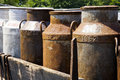 Old milk churns on a cart Royalty Free Stock Photo