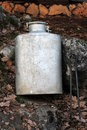 Old milk container in forest Stock Photography