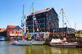 Old Mill hotel on the main city quay. Danes river canal. Klaipeda