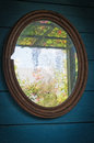 Old mirror an in a wooden frame Stock Images