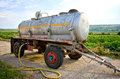 Old mobile cistern type of for milk water or fuel on the road Stock Image