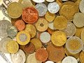 stock image of  Old money coins of different countries on dollar background