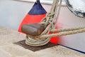 Old mooring bollard and boat in port croatia Stock Images