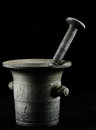 Old mortar with pestle on black backround Royalty Free Stock Images