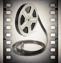 Old motion picture film reel with film strip vintage background Royalty Free Stock Image