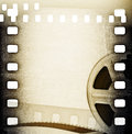 Old motion picture film reel with film strip vintage background Royalty Free Stock Images