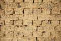 Old mud brick wall detail Stock Images