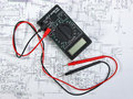 Old multimeter on the wiring diagram Stock Image