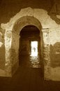 Old mysterious passageway in sepia tones Royalty Free Stock Photo