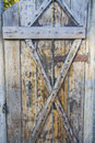Old mystery wooden door rusty in stonewall Stock Images