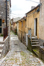 Old narrow cobbled street in a town Royalty Free Stock Photo
