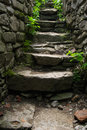 Old narrow stone stairs with brick wall. Explore concept Royalty Free Stock Photo