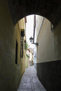 Old narrow street in granada spain Stock Photography
