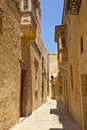 Old narrow street of mdina malta traditional in maltese architecture in Royalty Free Stock Images