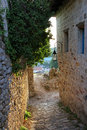 Old narrow street with stone walls in montenegro Royalty Free Stock Photos