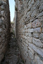 Old narrow street with stone walls in montenegro Royalty Free Stock Photo