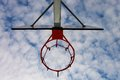 Old neglect basketball backboard with rusty hoop above street court blue cloudy sky in bckground retro filter Stock Photos