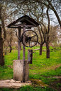Old, neglected well in garden of Ukrainian village. Royalty Free Stock Photo