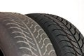 Old and new winter car tires fragment a modern Royalty Free Stock Image