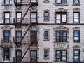 Old New York apartment building with external fire escapes, Royalty Free Stock Photo