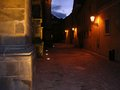 Old night street prague a beautiful view of the in with lamp and wall Royalty Free Stock Photo