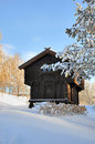 Old norwegian house surrounded by snow wood Royalty Free Stock Images