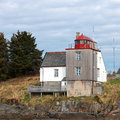 Old norwegian lighthouse with red top on the seacoast Stock Images