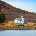 Old norwegian lighthouse stands on the seacoast Royalty Free Stock Images
