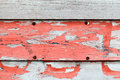 Old obsolete advertisement wooden wall with red paint and rusted pushpins Royalty Free Stock Photos