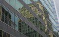 Old office buildings reflected in the glass of a modern office building Royalty Free Stock Photo