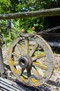 Old one aged wooden cart wheel in farm Stock Images