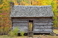 Old one room log cabin during autumn in smoky mountains preserved with fireplace and thatched roof Stock Photos