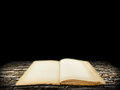 Old open book on stone grunge background Royalty Free Stock Photography