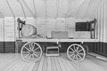 Old open horsedrawn wagon with wooden wheels and the barrel and boxes Royalty Free Stock Images