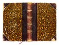 Old open shabby book cover in colorful abstract decorations with bookmark Royalty Free Stock Photo