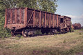 Old open wagon and hopper car industrial railway cars on on mining metallurgical plant Stock Photo